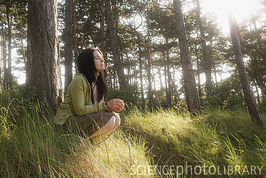 Woman crouching in contemplation
